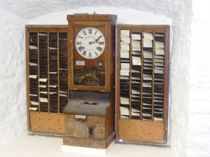 Early time clock, made by National Time Recorder Co. Ltd. of Blackfriars, London at Wookey Hole Caves museum.