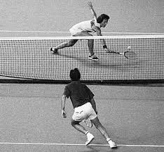 "Billie Jean King breaking glass against Bobby Riggs in the 1973 ""Battle of the Sexes."" Ms. King won in straight sets."